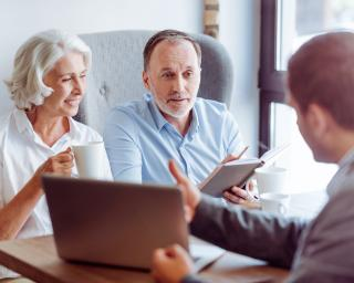 Older couple getting insurance advice
